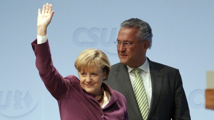 Bayerns Innenminister Joachim Hermann (CSU) mit Angela Merkel
