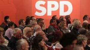 Delegierte auf dem Parteitag