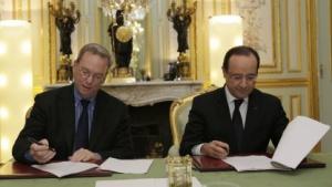 Eric Schmidt (l.) und François Hollande