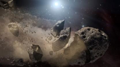 Eine Künstlerzeichnung eines zerfallenden Asteroiden