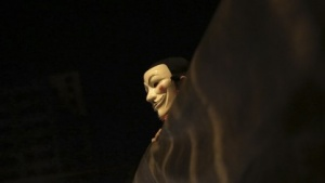 Demonstrant in Brasilien mit Guy-Fawkes-Maske