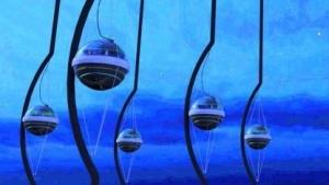 Sensoren des Ice Cube unter dem Eis (Symbolbild): schwaches bläuliches Leuchten