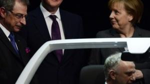 Dieter Kempf und Angela Merkel (von links nach rechts)