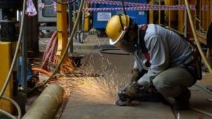 Arbeiter auf der Werft Daewoo (Symbolbild): schneller, mehr Tragkraft