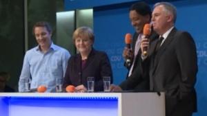Oliver Samwer, Angela Merkel, Cherno Jobatey und Eduard Sailer (v.l.n.r.)