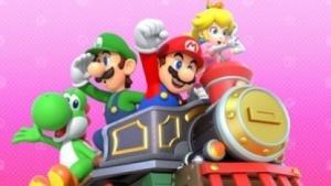 Yoshi, Luigi, Mario und Peach freuen sich.