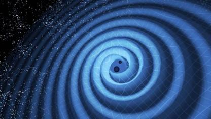 Zwei Schwarze Löcher verschmelzen miteinander und erzeugen dadurch Gravitationswellen.