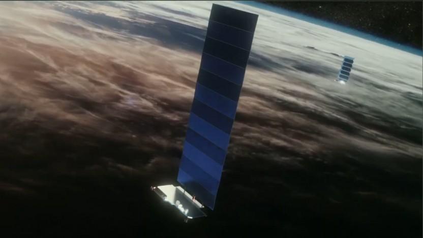 Eine künstlerische Darstellung zeigt die Satelliten beim Ausklappen der Solarzellen.