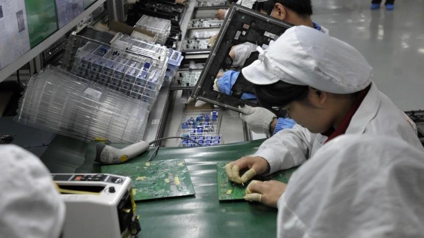 Arbeiter in einem Foxconn-Werk in Shenzhen, China