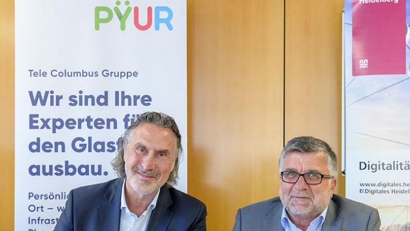 Rüdiger Schmidt, Chef der Tele-Columbus-Tochter Pepcom, und Heidelbergs Bürgermeister Hans-Jürgen Heiß (rechts)