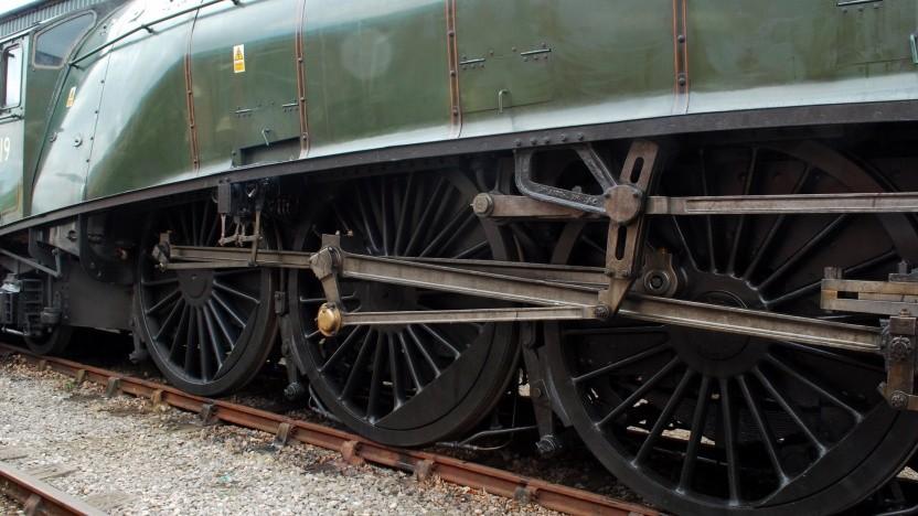 Eine stilisierte Kuppelstange einer Dampflokomotive dient als Logo von Steam.